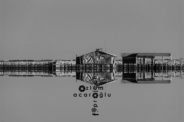 Adana Yumurtalik Lagoon National Park, reflection of fishing huts, Turkey