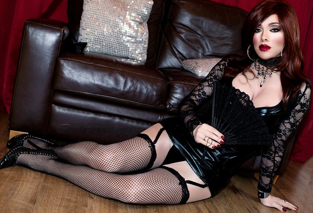 Leather corset, fishnet and high heels