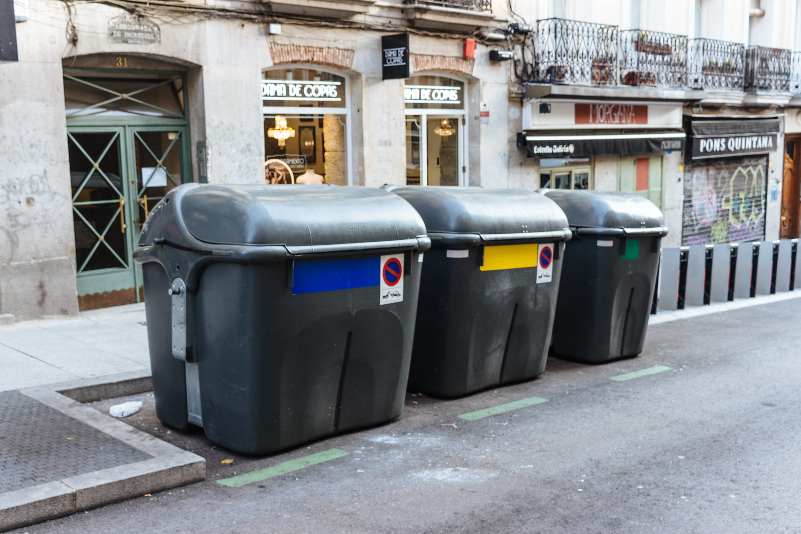 Paper, plastic, and trash bins in Madrid, Spain