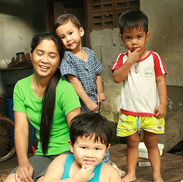 mother and son with neighbor childen