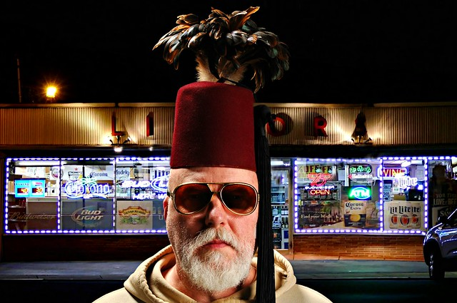 Wearing a Feathered Fez outside Freddie's Discount Liquor