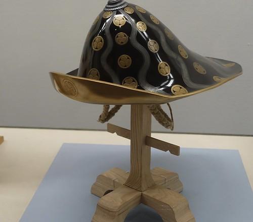 War Hat worn by 15th shogun Tokugawa Yoshinobu with hollyhock Crests on black lacquer