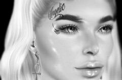 ANGELIC FACE TATTOO