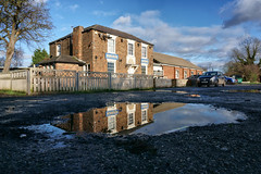 Haven Arms reflective puddle.