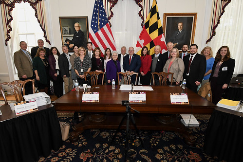 Photo of Governor Hogan, Comptroller Franchot, Treasurer Kopp, Secretary Riccio and representatives of several Rural Legacy Areas in the governor's conference room.