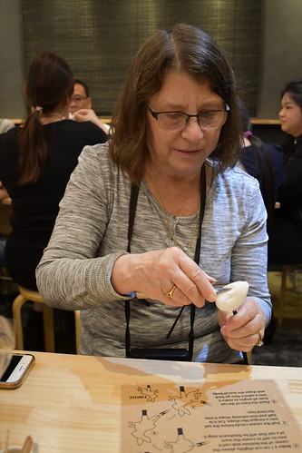 Sandy attempting to make a Japanese Candy Rabbit. From History Comes Alive in Tokyo