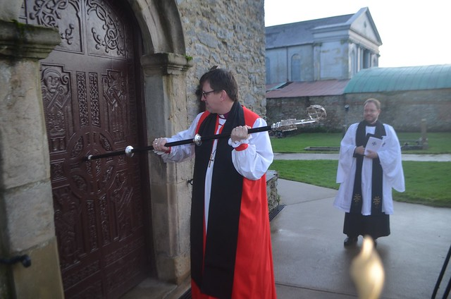 Bishop Andrew Forster strikes the door of St Eunan's Cathedral with his pastoral staff, during the Service of Installation in Raphoe.