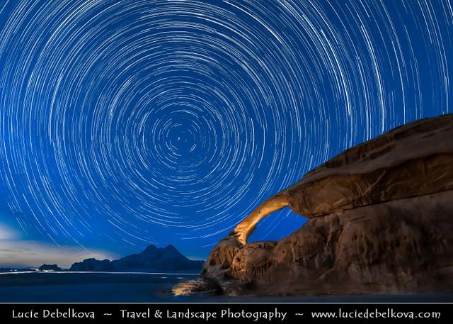 Jordan - Wadi Rum - UNESCO World Heritage Site - Startrails over famous Rock Arch