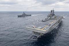USS America (LHA 6) and Japan Maritime Self-Defense Force amphibious transport dock ship JS Kunisaki (LST 4003) steam together in the East China Sea. (U.S. Navy/MC3 Vincent E. Zline)