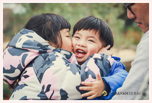 boy kissed by his sister, traveler to Nagoya, Japan, family photo shooting