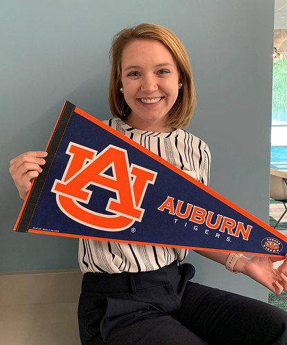 Megan Thompson holds an Auburn pennant.