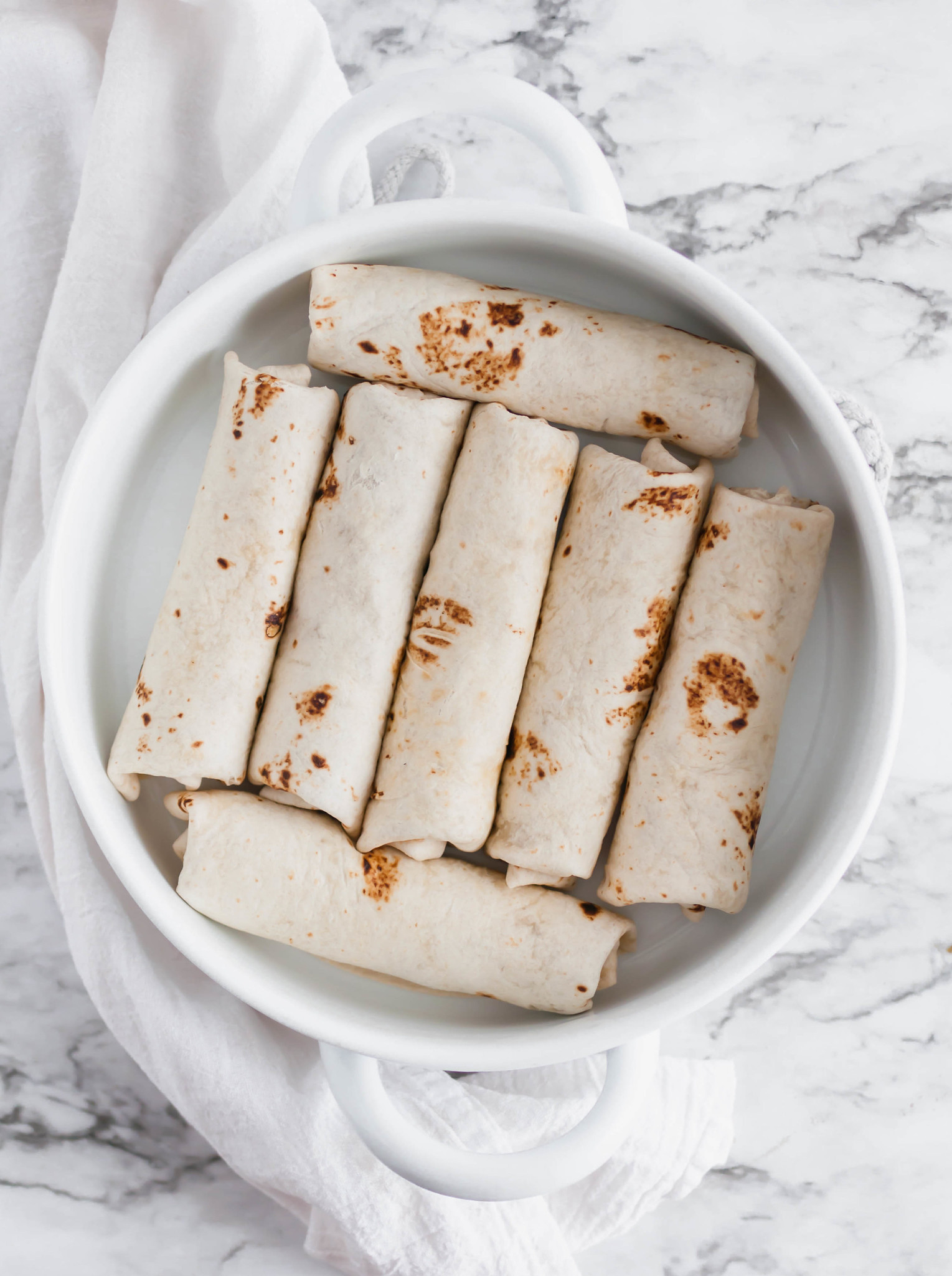 These Bean and Cheese Burritos are a great meal prep or easy dinner option. Freezer friendly with directions included.