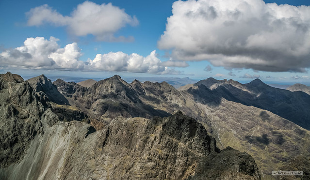 From the summit of Sgùrr Alasdair, 992 metres (3,258 feet), Black and Red Cuillins of the Isle of Skye, under shadows of passing clouds.