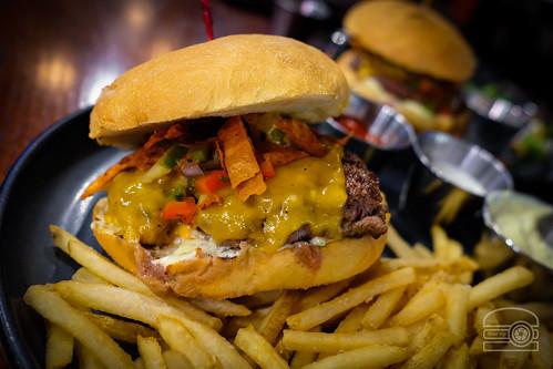Burger w/ pineapple salsa, spicy tortilla strips, cheddar, cilantro lime aioli - Table 9