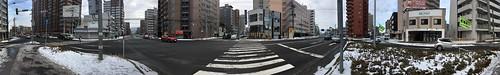 15january2020 edited panorama sapporo hokkaido japan buildings people downtown cars roads trafficsignals signs japanese snow weather