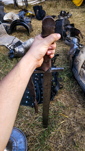 Thrusting a sword into the ground