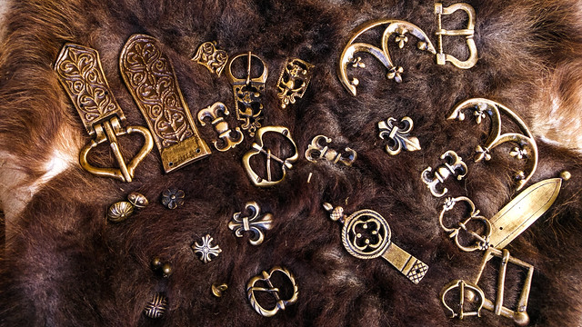 Brass metal pieces on fur. Medieval barbarian concept