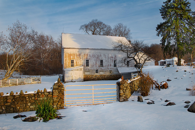 White Barn With Stone Wall