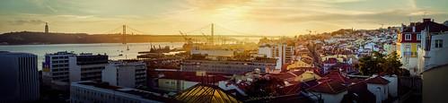 portugal lisbon sunset yellow river bridge shine sun panorama view evening winter sky urban town port
