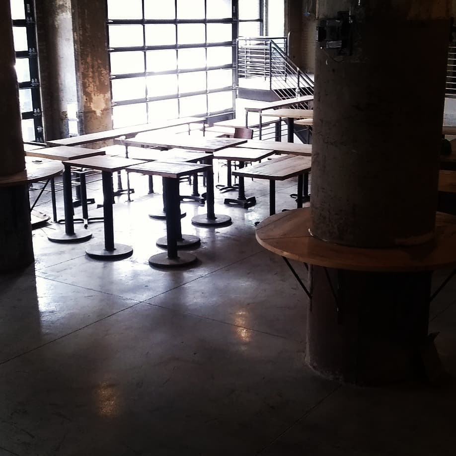 Reclaimed hemlock tables and salvaged bases, at Thin Man Brewery, Chandler Street in Buffalo.