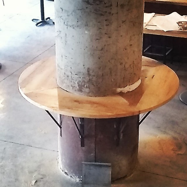 Reclaimed hemlock bar tops wrapped around a column at Thin Man Brewery, Chandler Street in Buffalo.