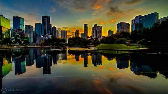 Sunrise and reflections at KLCC (Kuala Lumpur City Centre) Park, Malaysia