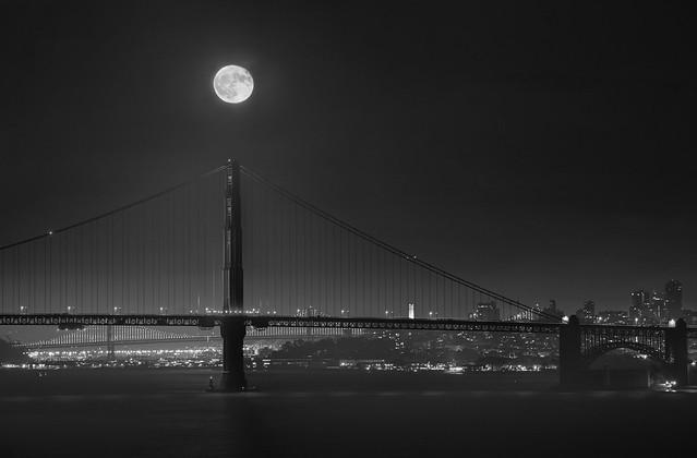 Harvest moon over Golden Gate Bridge