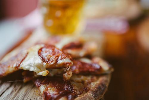 Slice of pizza with salami closeup