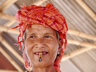 Taung Yeo woman with cheroot, Thaung Taung market, Inle,Myanmar