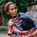 Laotian woman carrying a baby 2