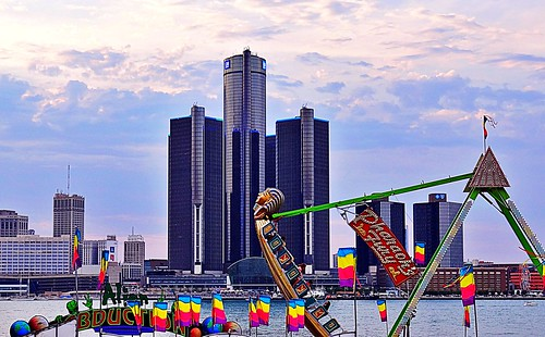 Windsor, Canada Fair at the shore of the Detroit River with the General Motors Buildings in the City of Detroit on the background.