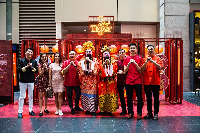 Guests posing with the double Choi San Yeh's, The God of Prosperity, during the Tiger Beer CNY Media Launch at Pavilion KL