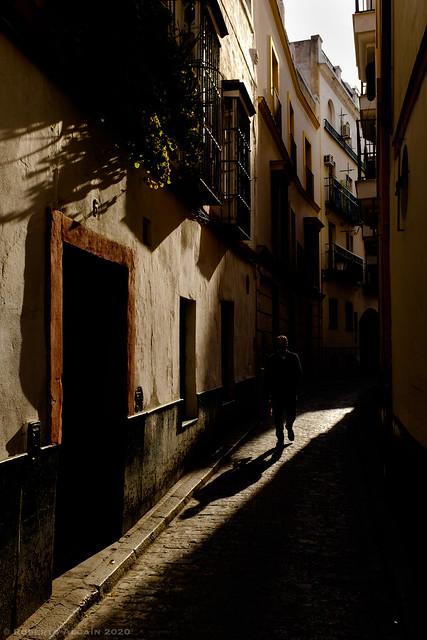 Shadow in a narrow street