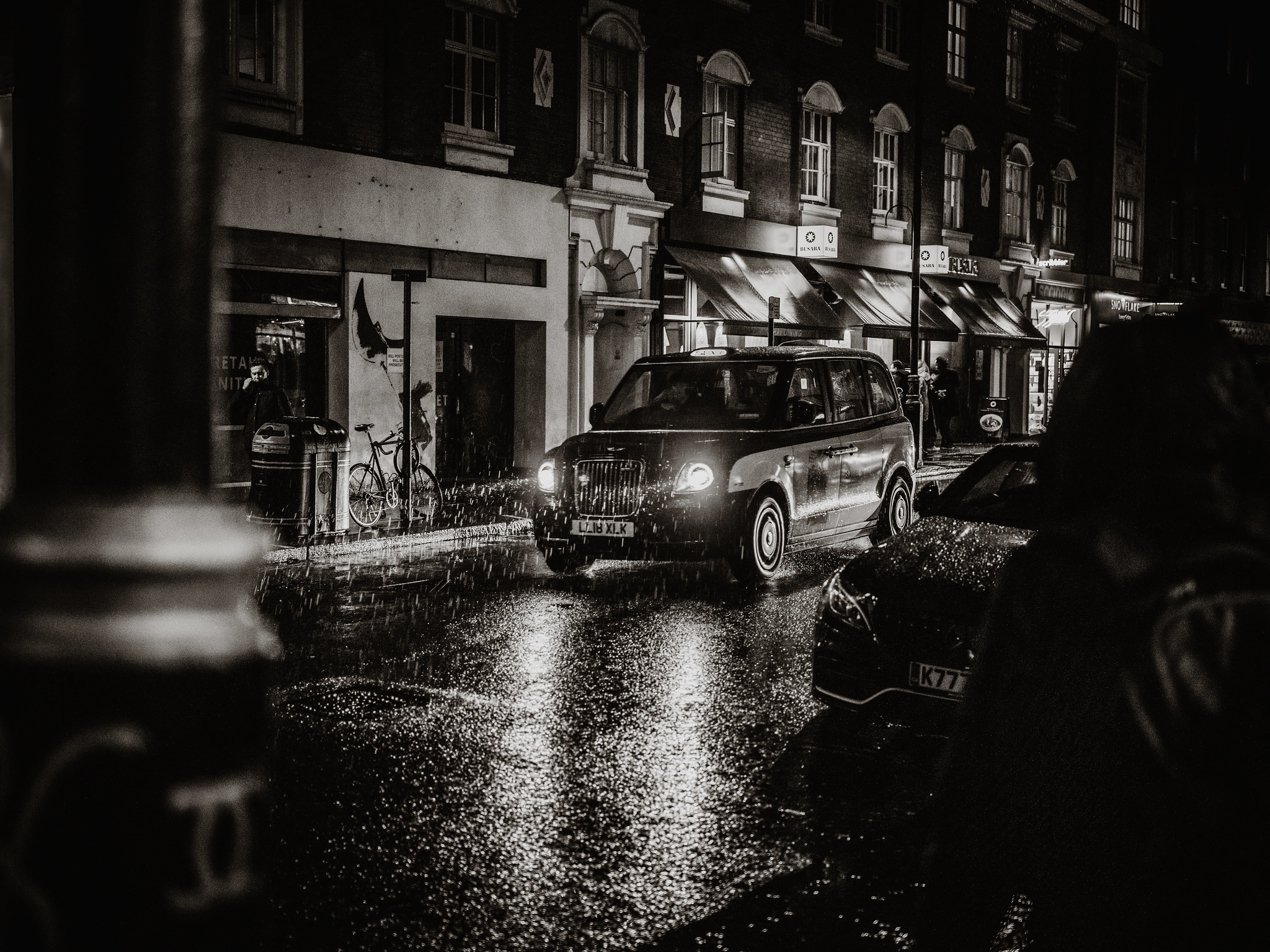 Taxi driving through the rain