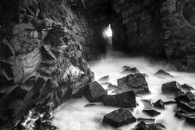 light the the end of the tunnel - sea cave broken open at  Collieston, Aberdeenshire, Scotland.