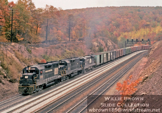 Back when it wasn't unusual to see solid sets of 4 axles powering freights on the mountain. October 6th 1977 has a GP35 leading a GP40 & U33B.