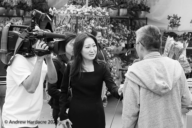 TVB journalist Hailey Jo interviewing at the LNY flower fair