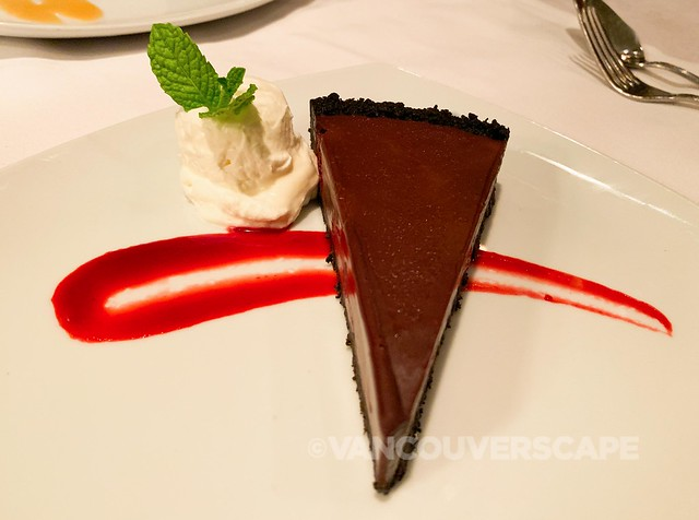 Chocolate raspberry truffle tart, preserved berry coulis, whipped cream