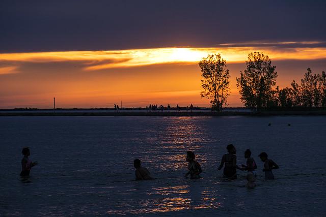 last swim as the sun sets in Muskegon