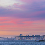 18. Jaanuar 2020 - 17:23 - Nice pastel sunset sky over part of the San Diego downtown skyline with the San Diego-Coronado Bridge front of it.   Shot from Chula Vista Harbor tonight (January 18, 2020). Canon EOS R and Sigma 150-600mm lens at 0.3 sce f/5.6 ISO 100 212mm. This is a single frame from a timelapse sequence I shot here tonight. Timelapse to be posted soon.