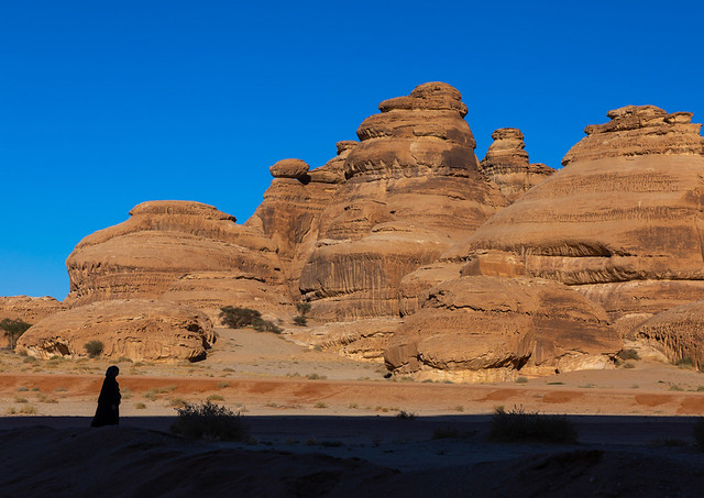 Woman silhouette in the rocky landscape of Madain Saleh, Al Madinah Province, Alula, Saudi Arabia