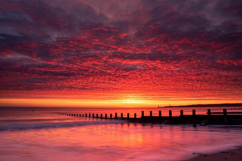 aberdeen aberdeenbeach sunrise sunset landscape longexposure scotland red sea sky sand groyne canon canon5d eos
