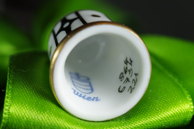 on the inside of a handpainted thimble