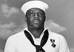 Mess Attendant 2nd Class Doris Miller stands at attention after being awarded the Navy Cross on May 27, 1942. (U.S. Navy)