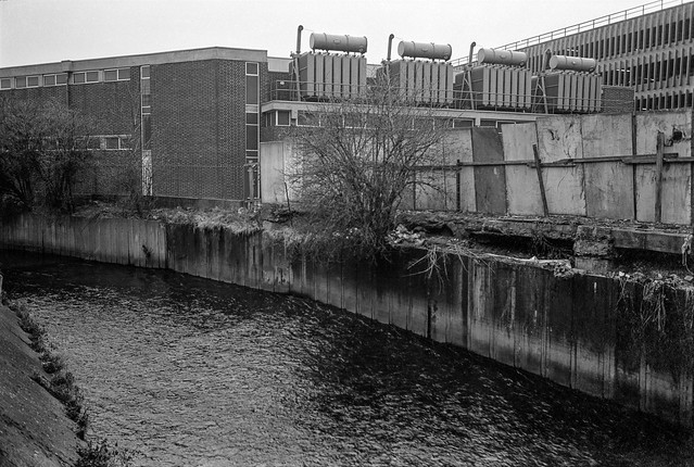 River Wandle, Wandsworth. 1982 30i-26: substation, river, car park,