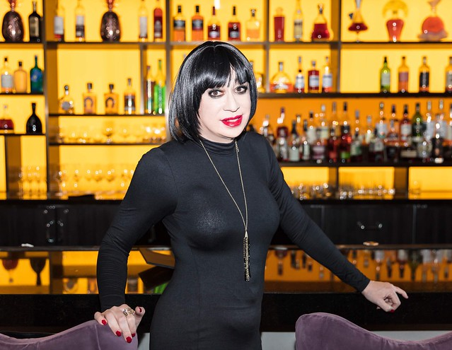 At the MGM lobby bar wearing a black bodycon dress