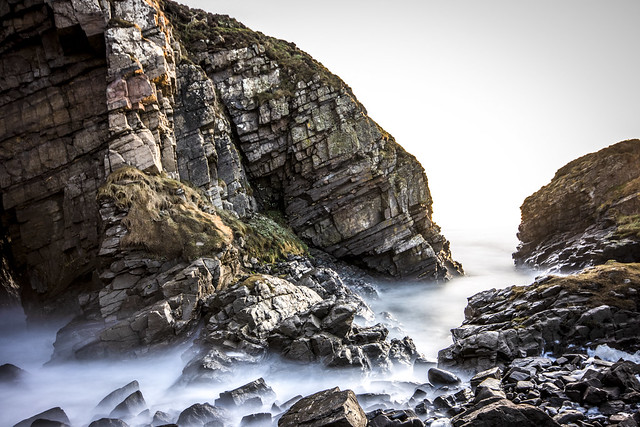 what lies outside this sheltered little inlet in the granite cliffs? Collieston, Aberdeenshire, Scotland.