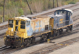 CSX MP15T 1211 (ex-SBD 1211) and MP15DC 1141 (ex-L&N 5031) kicking cars (flat switching) in Gentilly Yard, New Orleans, LA on December 22, 2007