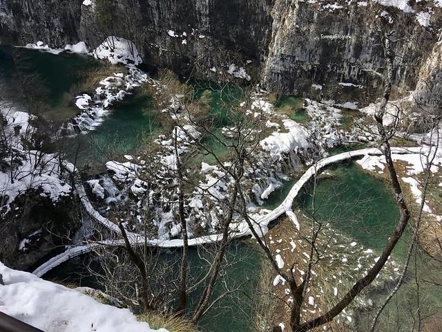 The lower hikingtrail through the falls full of snow  Photo taken in Plitvice lakes Croatia