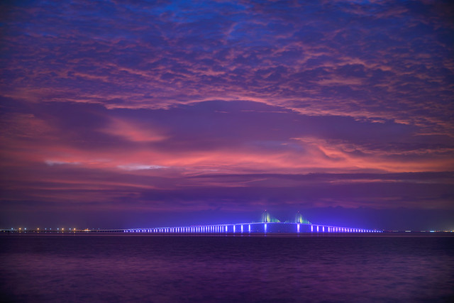 Pre-dawn clouds over the illuminated Sunshine Skyway Bridge, Fort De Soto Park, St. Petersburg - Florida